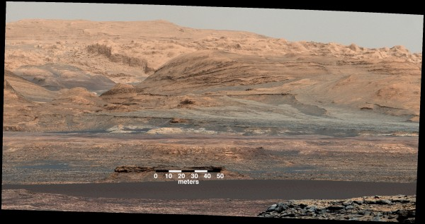 The dark band in the lower portion of this Martian scene is part of the