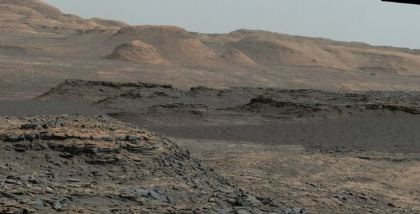This Sept. 25, 2015, view from the Mast Camera on NASA's Curiosity Mars rover shows a dark sand dune in the middle distance.  Image credit: NASA/JPL-Caltech/MSSS