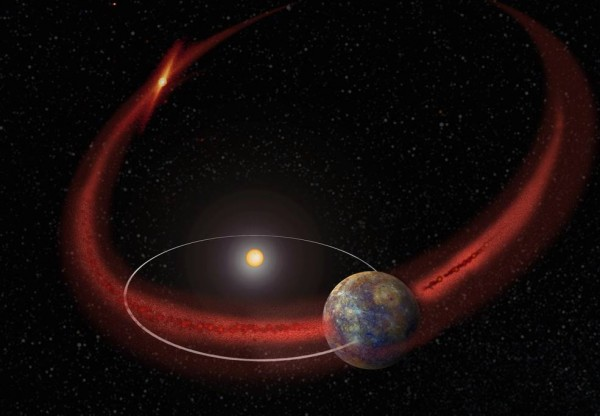 Artist's concept of the planet Mercury crossing the stream of debris left behind by Comet Encke. New research suggests that, at these crossings, Mercury undergoes a recurring meteoroid shower. Image via NASA/Goddard.