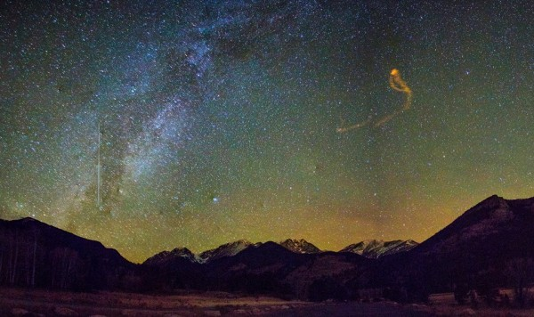 View larger. | Joe Randall in Colorado caught one Taurid fireball (left side of photo) and a debris trail left by a second one (red swirl on right).  Thanks, Joe!