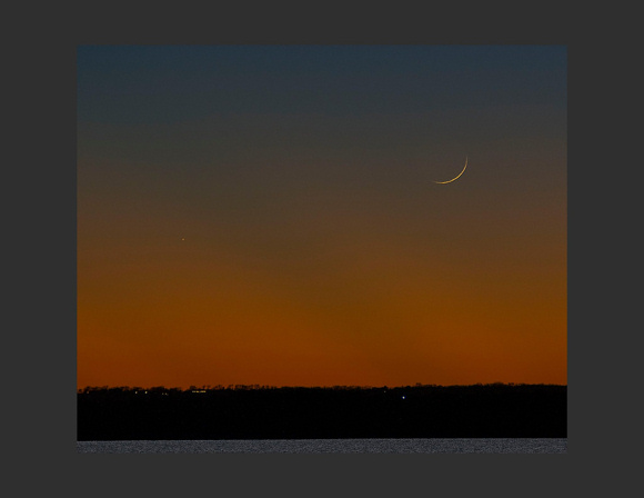 View larger.Congratulations to Michael C DuPree, who caught the young waxing crescent moon and the planet Saturn after sunset November 12. One day later, on November 13, a wider waxing crescent will be higher up at sunset and will stay out later after dark.  Thank you for the wonderful photo, Michael!