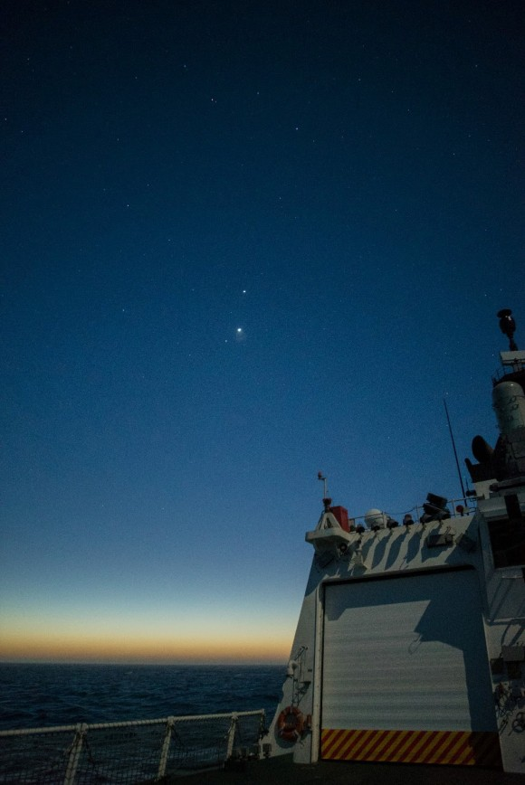 Morning planets, as seen from the middle of the Pacific Ocean. Brightest one is Venus.  Mars just below it.  Jupiter - second-brightest - above Venus.  Bryan Goff took this photo on October 30.  He wrote: