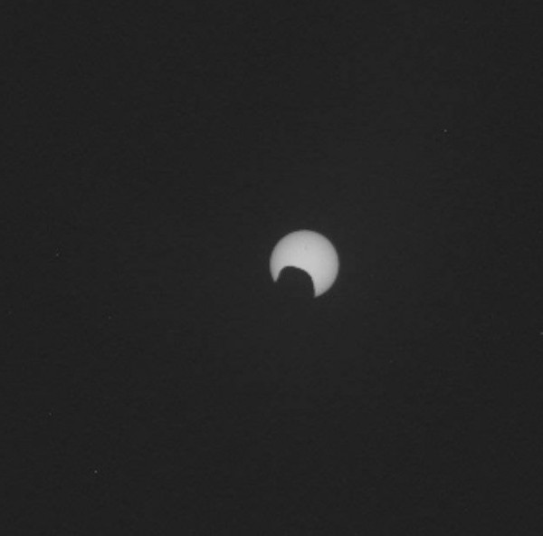 A Solar Eclipse from Mars. Curiosity captured Phobos, one of the two small martian moons passing in front of the Sun in July, 2015. Although Phobos is only about 14 miles (22.5 km) in diameter, it orbits Mars at just 6,000 km ( 3,728 miles) which is relatively close. Image via NASA/JPL-Caltech/MSSS