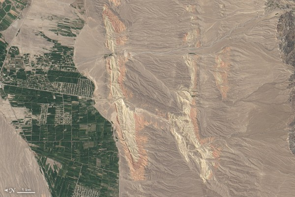 On August 30, 2014, the Operational Land Imager on Landsat 8 acquired this image of rivers running through colorful ridges in southwestern Kyrgyzstan. Image credit: NASA