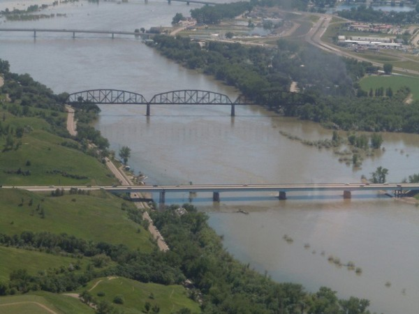 "If the Anthropocene is formally defined as a geological epoch beginning in 1945 (scenario C in Figure 1), then newer structures, such as the Grant Marsh Interstate 94 bridge over the Missouri River in Bismarck, N.D. (foreground), would be classified as ""Anthropocene."" Older structures with or without recent updates, such as the Bismarck railroad bridge (center) would be classified as Holocene and Anthropocene. Photo credit: Joel M. Galloway, USGS"
