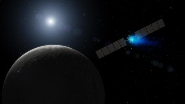 Artist's conception of the Dawn spacecraft arriving at Ceres. The engine's xenon ions glow with blue light. Image credit: NASA/JPL-Caltech
