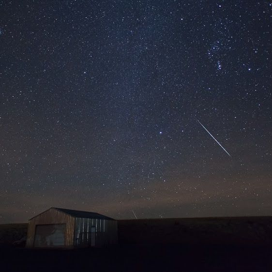 Susan Jensen said her sky finally cleared, and she caught these meteors around midnight on December 14.