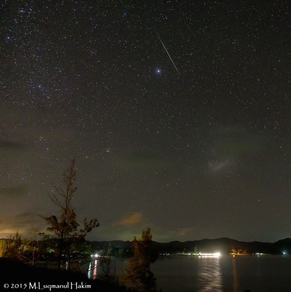 This Geminid meteor caught by Muhd Luqmanul Hakim at the tip of Borneo, Kudat Sabah, Malaysia - looks as if it's aimed for the Large Magellanic Cloud. Thank you, Muhd!