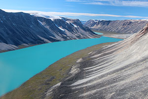 n western Greenland, small outlet glaciers are wasting backward, leaving behind piles of rocks, or moraines, that mark their previous advances. Meltwater has formed a lake.  Image credit: Jason Briner