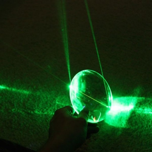 A green laser reflecting through glass. Credit: Astroshots42 on Flickr/ One Universe at a Time.