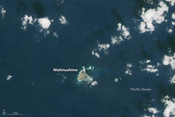 Landsat 8 captured images of the old and new island of Nishinoshima. This image shows the area on November 6, 2013, two weeks before the eruption started. Image via NASA Earth Observatory.