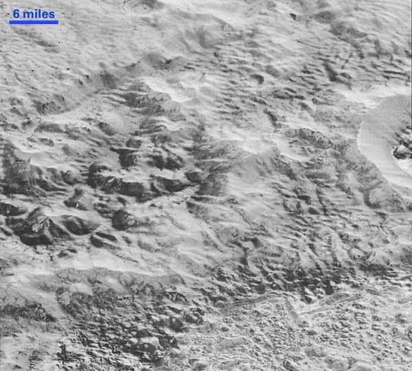 More hummocky, hilly terrain on Pluto.