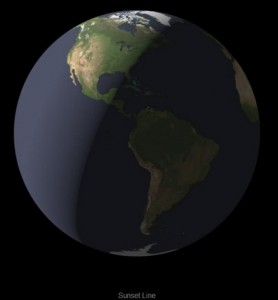 Earth globe showing the Americas with half the globe in darkness and half light.