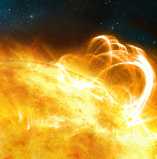 What the Sun might look like if it were to produce a superflare. A large flaring coronal loop structure is shown towering over a solar active region. Image credit: University of Warwick