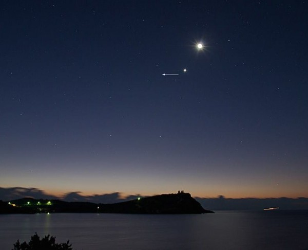 View larger. | Nikolaos Pantazis caught the moon, Venus and Comet Catalina from Cape Sounion, Greece on December 7.