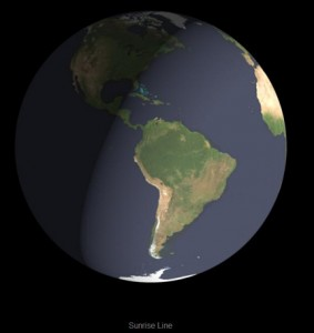 Globe of Earth divided into dark half and light half at an angle.