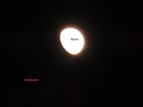 This photo illustrates what the eye alone would have seen: a bright moon with a bright star in its glare.  Aniruddha Bhat in Maryland wrote: