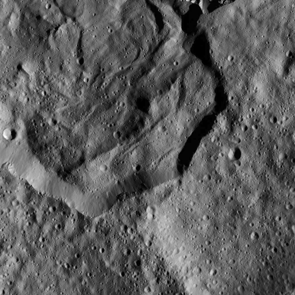 View larger.   Messier Crater from 240 miles (385 km) above Ceres.