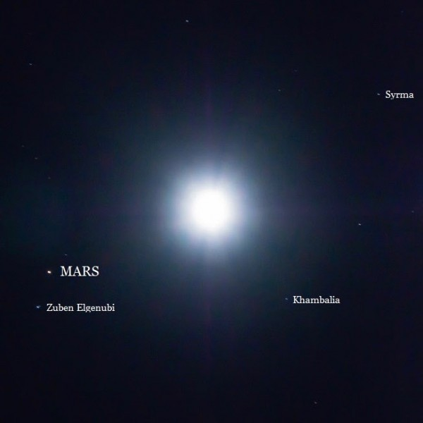 Vince Babkirk in Thailand caught the moon and Mars from Thailand on the morning of February 1, 2016.