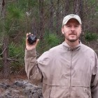 Josh Brendan holds up a meteorite - a chunk of rock from space - associated with the January 24 2016 daylight meteor over the U.S. Southeast.  Photo via MikeAstroPhotos.com.  Used with permission.