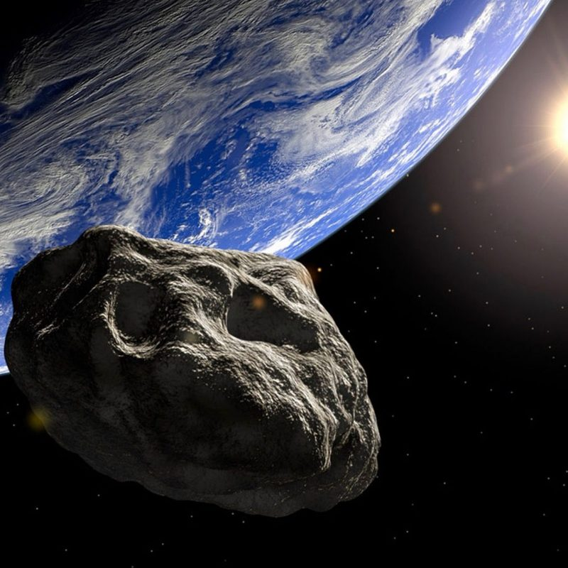 Large space rock appearing close to Earth seen from space.
