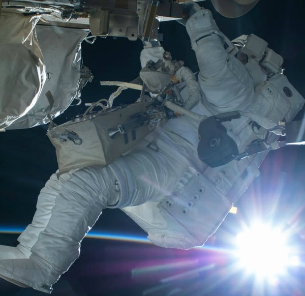 Astronaut Terry Virts conducts a spacewalk during an orbital sunrise on February 21, 2015. Image credit: NASA