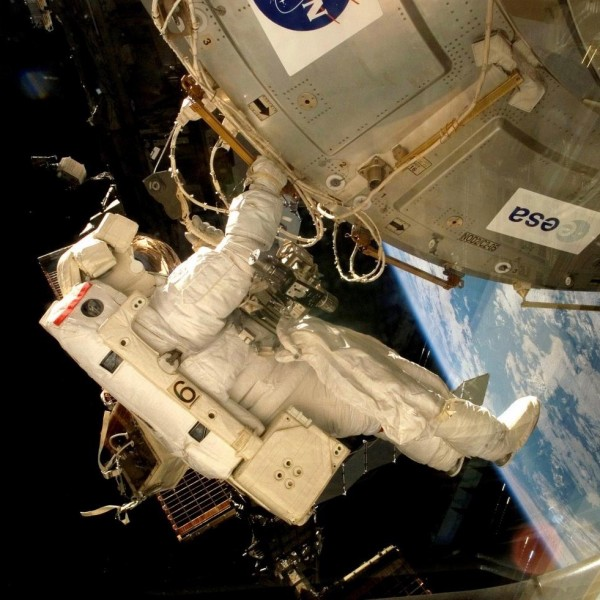 An astronaut fixes the EXPOSE-E platform onto the International Space Station. Image via ESA