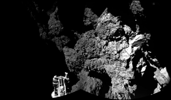 Rosetta's lander Philae is safely on the surface of Comet 67P/Churyumov-Gerasimenko, as this mosaiced CIVA image confirms. One of the lander's three feet can be seen in the foreground. The image above is a two-image mosaic. Image credit: ESA/Rosetta/Philae/CIVA