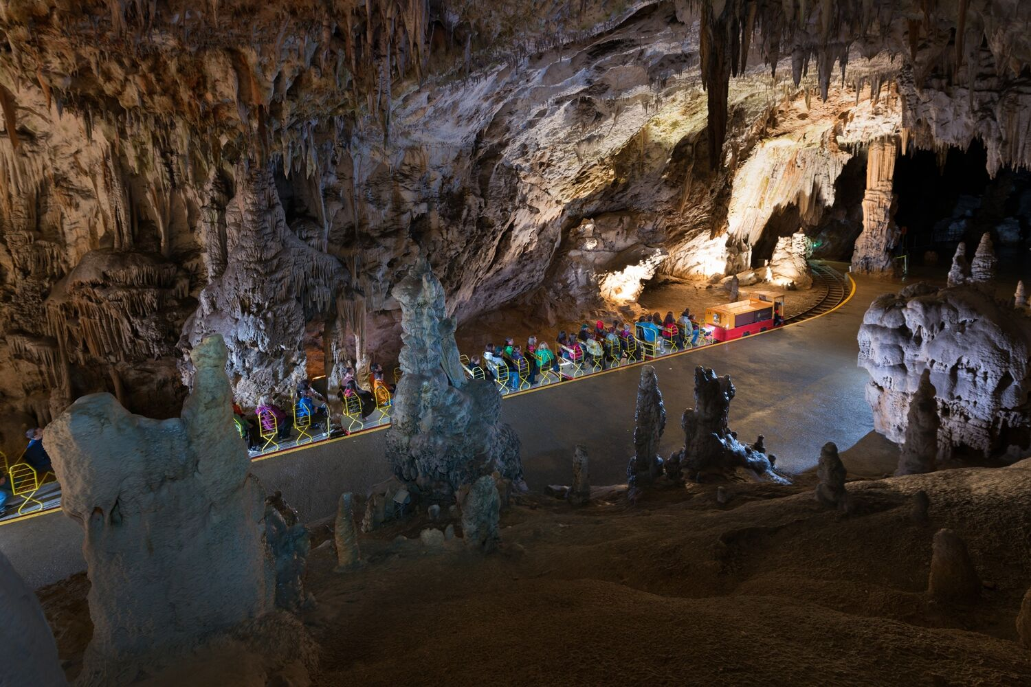 A train carries tourists on a tour of Postojna Cave. Image credit: Postojna Cave Park.