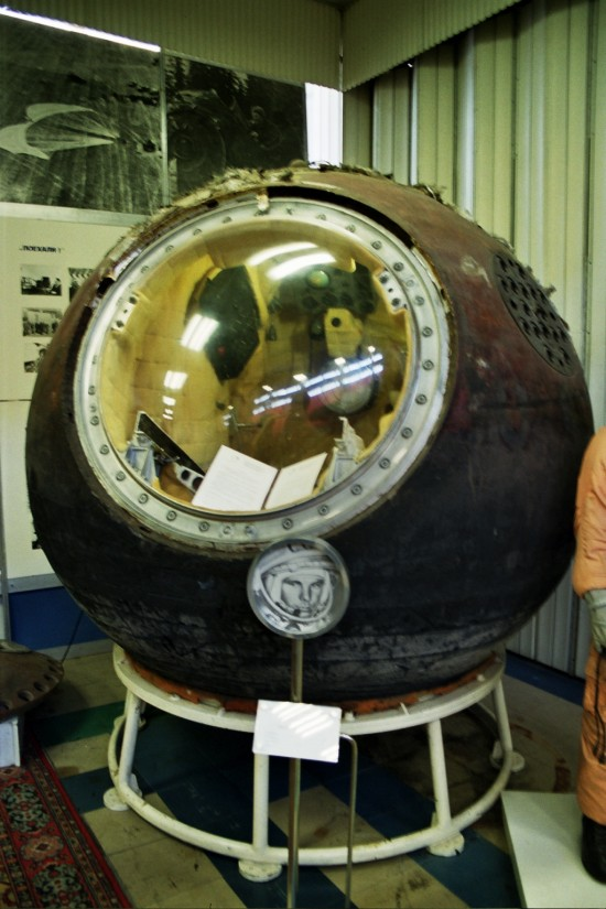 Spherical space capsule with large round window, barely big enough for one person.