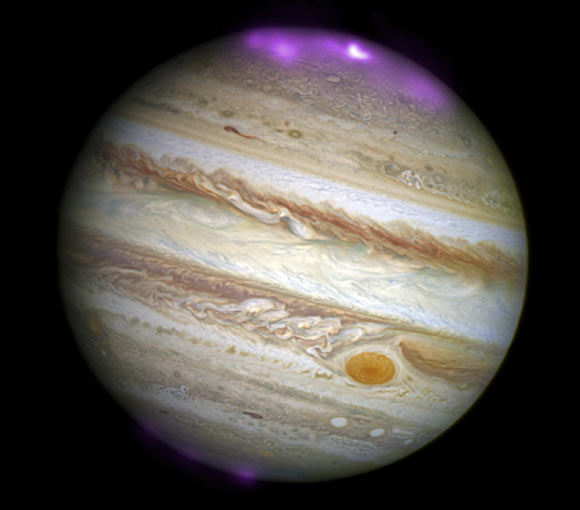 This is a Hubble Space Telescope image of Jupiter - with the strength of X-ray auroras October 2, 2011 indicated.  The Chandra X-ray observatory found these auroras to be about 8 times brighter than normal over a large area of the planet. Image credit: X-ray – NASA / CXC / UCL / W. Dunn et al.; Optical – NASA / STScI.