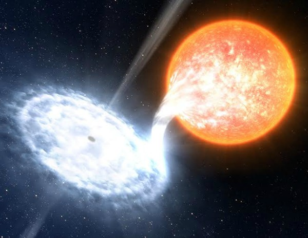 Artist's impression of a black hole, similar to V404 Cyg, devouring material from an orbiting companion star. Image credit: ESO/L. Calçada.