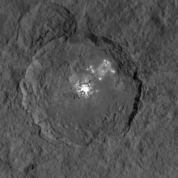 This image taken from NASA's Dawn spacecraft in orbit around the dwarf planet Ceres shows the very bright patches of material in the crater Occator and elsewhere. New observations using the HARPS spectrograph on the ESO 3.6-metre telescope at La Silla in Chile have revealed unexpected daily changes on these spots, suggesting that they change under the influence of sunlight. Image credit: NASA/JPL-Caltech/UCLA/MPS/DLR/IDA