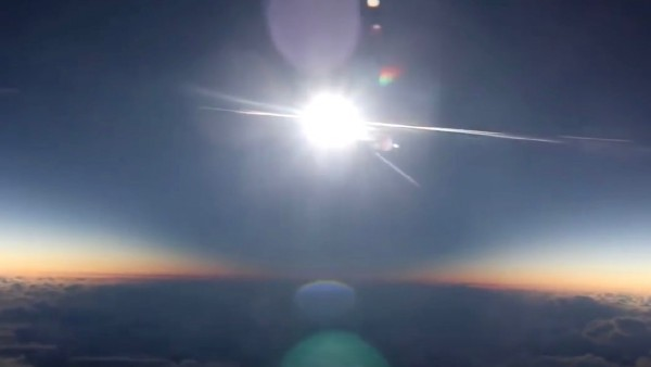 Around 10 seconds into the video, you can clearly see the moon's shadow sweeping toward the video camera ... The brightest thing here is the sun (about to be eclipsed).  The other bright things are lens flares, internal reflections from the camera.
