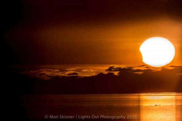 Partial solar eclipse at sunset as seen from Anchorage, Alaska, by Matt Skinner. Thank you, Matt!