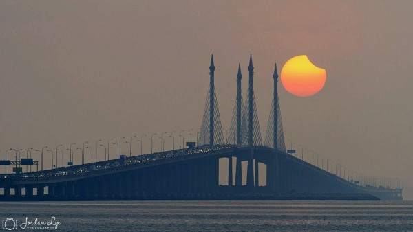 Jordan Lye Photography in Penang, Malaysia caught the partial phases of the eclipse. He wrote: