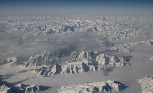 View larger. | The Oceans Melting Greenland (OMG) field campaign team is flying NASA's G-III aircraft at about 40,000 feet. On a clear day, this altitude also provides a stunning perspective of one of the world's two great ice sheets (the other is Antarctica). The flight Saturday, March 26, over the northeast coastline was one of those clear days. Read more about this image.