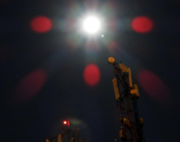 Here's another artful use of lens flares in capturing the moon and Jupiter on March 21, 2016.  Jupiter is the small white dot next to the moon. Photo by Helio C. Vital in Rio de Janeiro, Brazil, who wrote: