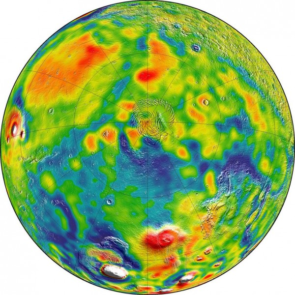 A map of Mars' gravity looking down on the planet's north pole (center). White and red are areas of higher gravity; blue indicates areas of lower gravity. Image via MIT/UMBC-CRESST/GSFC