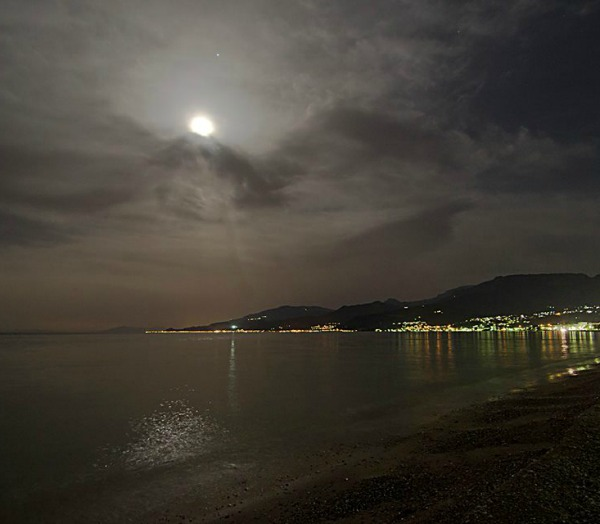 The moon and Jupiter in a cloudy sky, over the Gulf of Corinthos, Central Greece. Photo by Nikolaos Pantazis