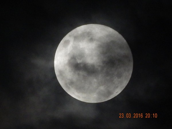 It looks like Ria Fakhriyyah in Jakarta, Indonesia may have caught the penumbral eclipse through thin clouds.  Nice image, Ria!