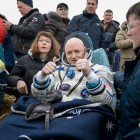 Two thumbs up from NASA Astronaut Scott Kelly, seen resting in a chair outside of the spacecraft just minutes after he and Russian cosmonauts Mikhail Kornienko and Sergey Volkov of Roscosmos landed in a remote area near the town of Zhezkazgan, Kazakhstan on Wednesday, March 2, 2016 (Kazakh time).  Photo: NASA/Bill Ingalls