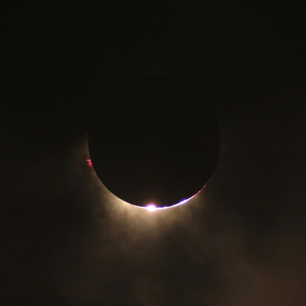 View larger.   Hazarry Haji Ali Ahmad was in Palembang, Indonesia for the eclipse.  He captured this image at totality with prominences, corona and diamond ring visible.