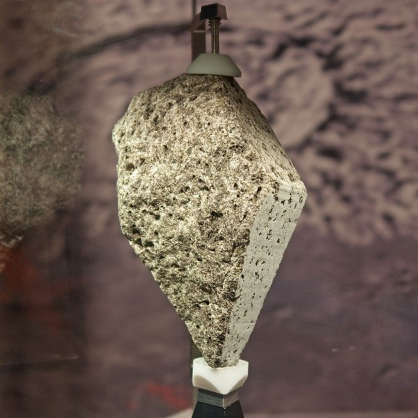Lunar olivine basalt collected by Apollo 15 astronauts, on display in the National Museum of Natural History. Image credit: Wknight94 via Wikimedia Commons.