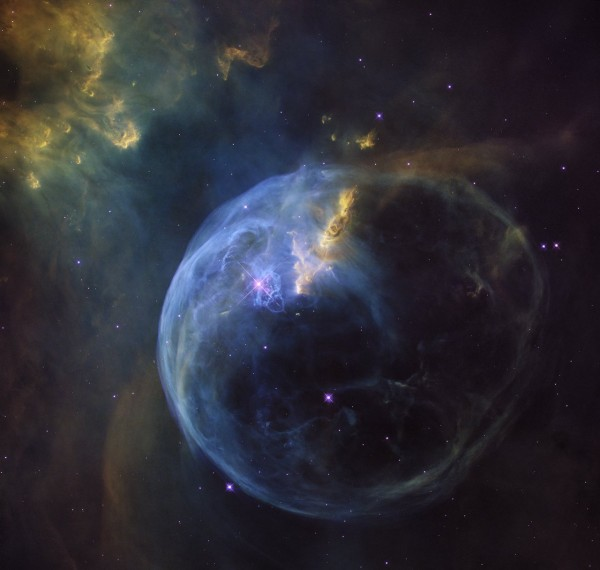 View larger.    The Bubble Nebula, also known as NGC 7653, is an emission nebula located 11,000 light-years away. Image credit: NASA, ESA, Hubble Heritage Team