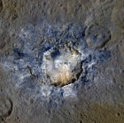 Ceres' Haulani Crater, shown in enhanced color, with a diameter of 21 miles (34 kilometers), shows evidence of landslides from its crater rim. Image credit: NASA/JPL-Caltech/UCLA/MPS/DLR/IDA