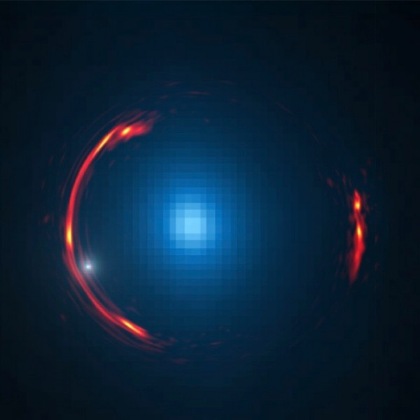 Composite image of the gravitational lens SDP.81 showing the distorted ALMA image of the more distant galaxy (red arcs) and the Hubble optical image of the nearby lensing galaxy (blue center object). By analyzing the distortions in the ring, astronomers have determined that a dark dwarf galaxy (data indicated by white dot near left lower arc segment) is lurking nearly 4 billion light-years away. Credit: Y. Hezaveh, Stanford Univ.; ALMA (NRAO/ESO/NAOJ); NASA/ESA Hubble Space Telescope