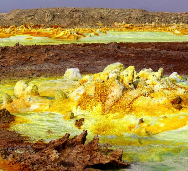 Hydrothermal system at the Danakil Depression. The yellow deposits are a variety of sulphates and the red areas are deposits of iron oxides. Copper salts colour the water green. Image credit: Felipe Gomez/Europlanet 2020 RI