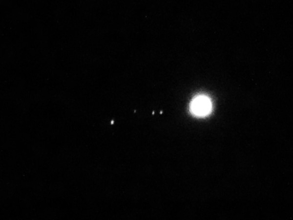 This isn't the moon and Jupiter.  It's Jupiter and its four largest moons, caught by Carl Galloway in La Porte, Indiana on April 18.. From left to right: Ganymede, Callisto, Europa, and Io. Thanks, Carl!