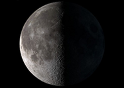 Left half of gray moon against black sky; right half invisible.